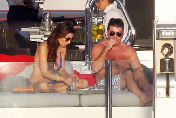 88908, ST. BARTHS, FRENCH WEST INDIES - Friday January 4, 2012.  Despite being in a 'casual' relationship with Carmen Electra,'XFactor' judge Simon Cowell gets cozy with bikini clad ex-fiance Mezhgan Hussainy on a private yacht in St Barths, where she tanned topless next to her former flame.   Photograph: ? PacificCoastNews.com **FEE MUST BE AGREED PRIOR TO USAGE** **E-TABLET/IPAD & MOBILE PHONE APP PUBLISHING REQUIRES ADDITIONAL FEES** LOS ANGELES OFFICE: 1 310 822 0419 LONDON OFFICE: +44 208 090 4079