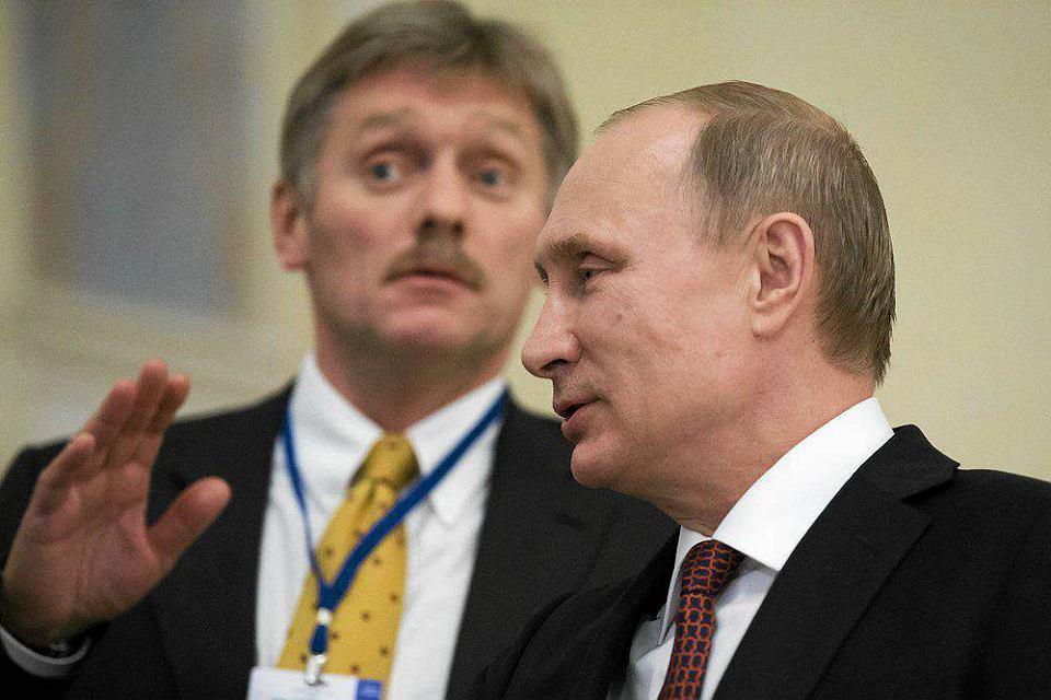 Rzecznik Kremla Dmitrij Pieskow i prezydent  Władimir Putin