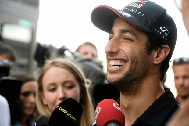 Australian Daniel Ricciardo of Red Bull is interviewed on the Hungaroring circuit  near Budapest, Hungary, Thursday, July 24, 2014, three days ahead of the Formula One Hungarian Grand Prix. (AP Photo/MTI, Szilard Koszticsak)