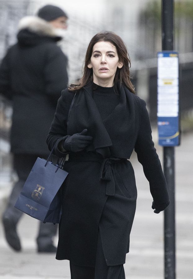 EXCLUSIVE: TV Chef Nigella Lawson Out Shopping In London.  Nigella showcased her ever shrinking frame in an all black outfit.  Shes seen returning from the boutique luxury candle retailer Cire Trudon.    Pictured: Nigella Lawson      World Rights