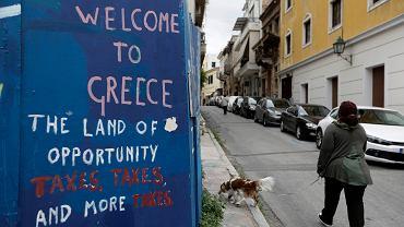 Grecja wstępnie porozumiała się z pożyczkodawcami / Graffiti w Atenach