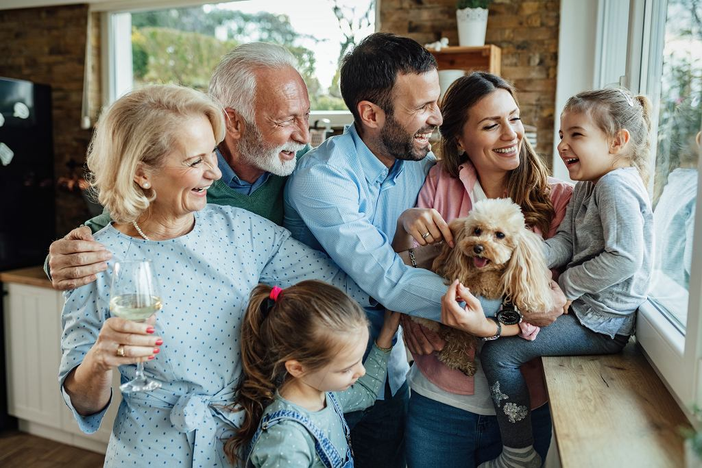 ECheerful,Multi-generation,Family,With,A,Dog,Having,Fun,While,Spending