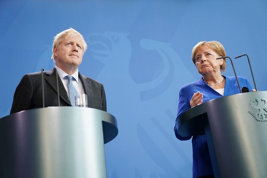 Niemcy i brexit. Premier Wielkiej Brytanii Boris Johnson i kanclerz Niemie Angela Merkel.