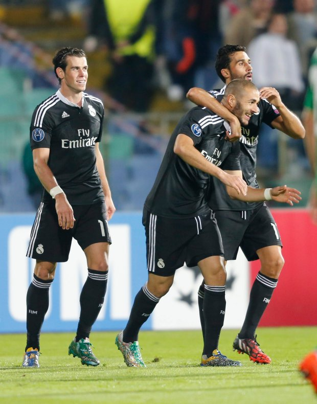 Real Madrids Benzema, center, celebrates his goal against Ludogorets during their Champions League group B soccer match at Vassil Levski stadium in Sofia, Wednesday, Oct. 1, 2014. (AP Photo)