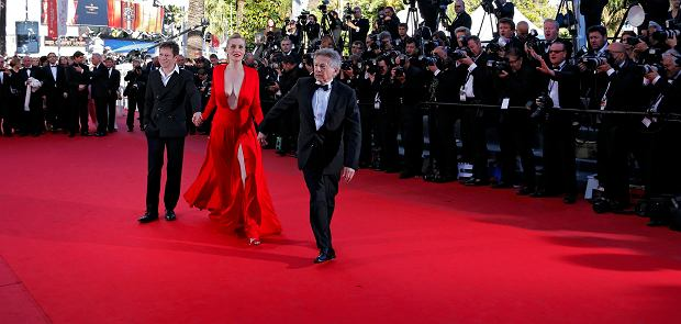"Director Roman Polanski (R), cast members Emmanuelle Seigner (C) and Mathieu Amalric (L) pose on the red carpet as they arrive for the screening of the film ""La Venus a la Fourrure"" (Venus in Fur) in competition during the 66th Cannes Film Festival in Cannes May 25, 2013.           REUTERS/Eric Gaillard (FRANCE  - Tags: ENTERTAINMENT TPX IMAGES OF THE DAY)"