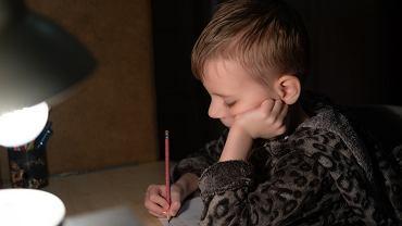 .First,Grader,Boy,Doing,Homework,In,The,Evening