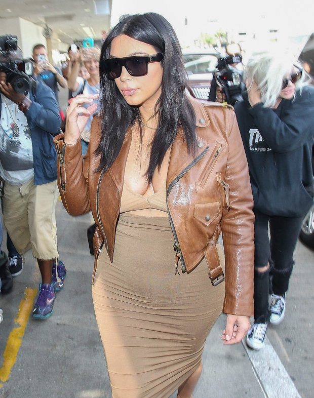 08/03/2015 - Kim Kardashian - Kim Kardashian Sighted at LAX Airport on August 3, 2015 - Los Angeles International Airport - Los Angeles, CA, USA - Keywords: 3/4 Length Shot, Ring, Necklace, Jewelry, Brown Leather Jacket, Brown Jacket, french manicure, white and tan nail polish, white and tan fingernail polish, Vertical, baby bump, pregnant, with child, tan and brown dress, long wavy black hair, Sunglasses. People, California, One Person, Beauty, Television Show, Portrait, Fashion, Arts Culture and Entertainment, Celebrities, Keeping up with the Kardashians
