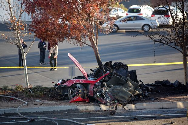 The aftermath of the tragic car crash that killed The Fast and the Furious' star Paul Walker. The 40-year-old actor was the passenger in a single-car accident and explosion in Santa Clarita, north of Los Angeles. The car hit a post or a tree and burst into flames. Walker had been attending a charity event for his organization 'Reach Out Worldwide'.  Pictured: Paul Walker crash scene
