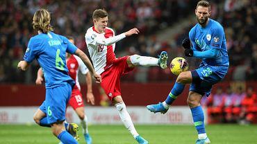 Sebastian Szymański w meczu Polska - Słowenia