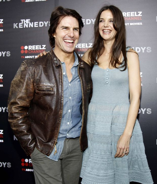 """Actor Tom Cruise poses with his wife and cast member Katie Holmes at the premiere of the television series """"The Kennedys"""" at the Samuel Goldwyn theatre in Beverly Hills in this March 28, 2011 file photo. Hollywood superstar couple Cruise and Holmes are planning to divorce, People magazine reported, citing Holmes' attorney. REUTERS/Mario Anzuoni/Files (UNITED STATES - Tags: ENTERTAINMENT)"""