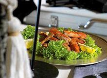 Szczypce kraba kamiennego lub królewskiego z masłem curry - ugotuj