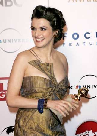 "English actress Rachel Weisz holds the award she won for best supporting actress for her work in ""The Constant Gardener,"" before the NBC Universal/Focus Features after-party following the 63rd Annual Golden Globe Awards on Monday, Jan. 16, 2006, in Beverly Hills, Calif. (AP Photo/Mark J. Terrill)"