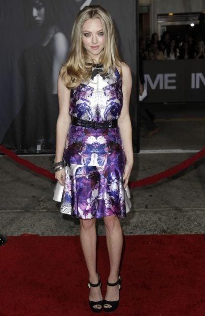 "Cast member Amanda Seyfried arrives at the premiere of ""In Time"" in Los Angeles, Thursday, Oct. 20, 2011.  ""In Time"" opens in theaters Oct. 28, 2011. (AP Photo/Matt Sayles)"