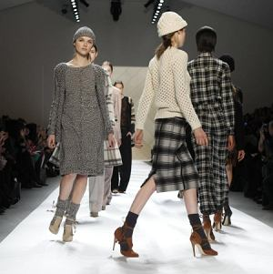 Models walk the runway at the Adam Fall 2011 show at Lincoln Center in New York, Saturday, Feb. 12, 2011.  (AP Photo/Kathy Willens)