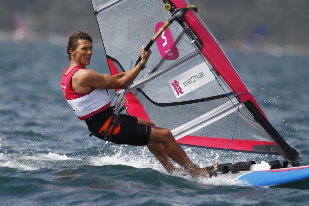 Przemyslaw Miarczynski of Poland competes during the RS:X windsurfer race at the London 2012 Summer Olympics, Saturday, Aug. 4, 2012, in Weymouth and Portland, England. (AP Photo/Francois Mori)