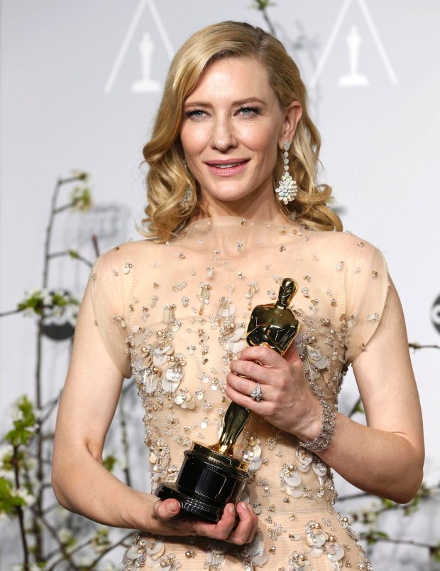 Best actress winner Cate Blanchett poses with her Oscar for her role in