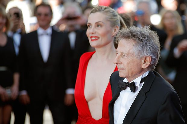 Director Roman Polanski, foreground, and his wife, actress Emmanuelle Seigner, arrive for the screening of the film Venus in Fur at the 66th international film festival, in Cannes, southern France, Saturday, May 25, 2013. (AP Photo/Lionel Cironneau)