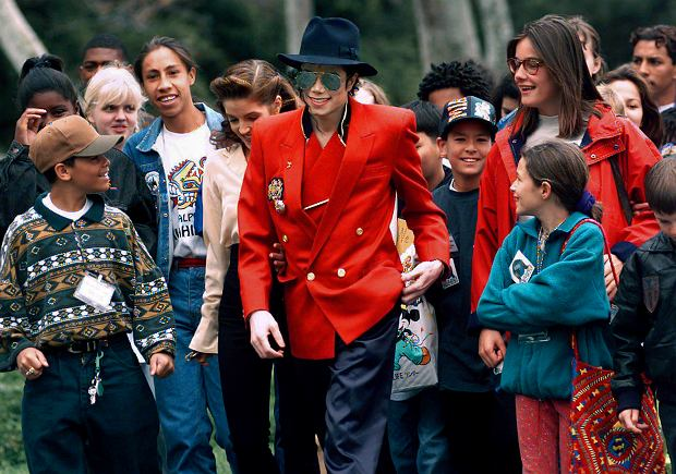 FILE - In this April 18, 1995, file photo, pop star Michael Jackson and Lisa Marie Presley, behind him at left, walk with children that were invited guests at his Neverland Ranch home in Santa Ynez, Calif. The co-executor of Jackson