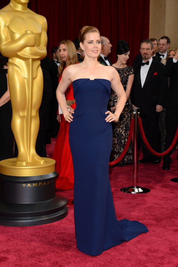 Amy Adams arrives at the Oscars on Sunday, March 2, 2014, at the Dolby Theatre in Los Angeles.  (Photo by Dan Steinberg/Invision/AP)