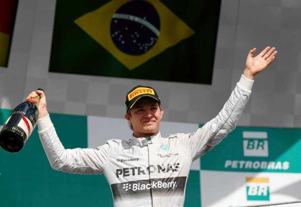 Mercedes driver Nico Rosberg, of Germany, celebrates the podium after winning the Formula One Brazilian Grand Prix at the Interlagos race track in Sao Paulo, Brazil, Sunday, Nov. 9, 2014. (AP Photo/Andre Penner) SLOWA KLUCZOWE: f1autoz12