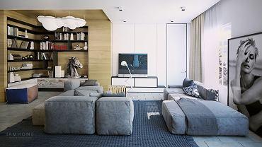 Dwie niskie sofy zachęcają do odpoczynku, a zastosowanie kolorów niebieskiego i szarego w przyjemnych odcieniach połączone z ciepłym drewnem tworzą relaksacyjny nastrój. W części bibliotecznej lampa w kształcie chmury Nemo Nuvola.