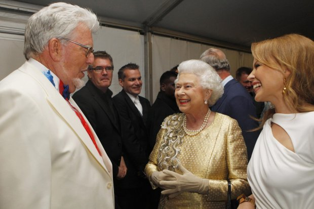 FILE - In this Monday June 4, 2012 file photo Queen Elizabeth II, centre, meets Rolf Harris and Kylie Minogue backstage at The Diamond Jubilee Concert  in London . A  jury Monday June 30, 2014 found broadcaster and entertainer Rolf Harris guilty of 12 counts of indecent assault.  The 84-year-old celebrity was convicted of indecent assault on four victims aged 19 or under between 1968 and 1986.   (AP Photo / Dave Thompson, Pool, File)