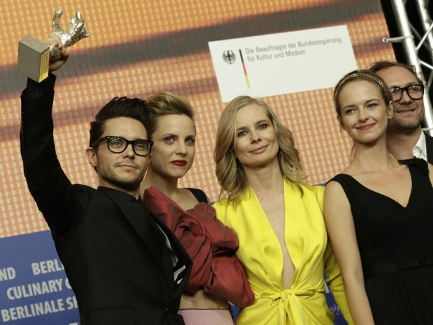 Director Tomasz Wasilewski and actresses Julia Kijowska, Magdalena Cielecka and Marta Nieradkiewicz, from left, pose for a photograph during the press conference after the award ceremony of the 2016 Berlinale Film Festival in Berlin, Germany, Saturday, Feb. 20, 2016. (AP Photo/Markus Schreiber)