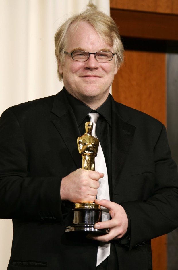 "Best actor winner Philip Seymour Hoffman poses with his Oscar for his work in ""Capote"" at the 78th annual Academy Awards in Hollywood in this March 5, 2006, file photo.  Hoffman, who was found dead in his apartment in New York City on February 2, 2014, died of an apparent drug overdose, a New York city police source said. REUTERS/Mike Blake/Files (UNITED STATES - Tags: ENTERTAINMENT PROFILE OBITUARY)"