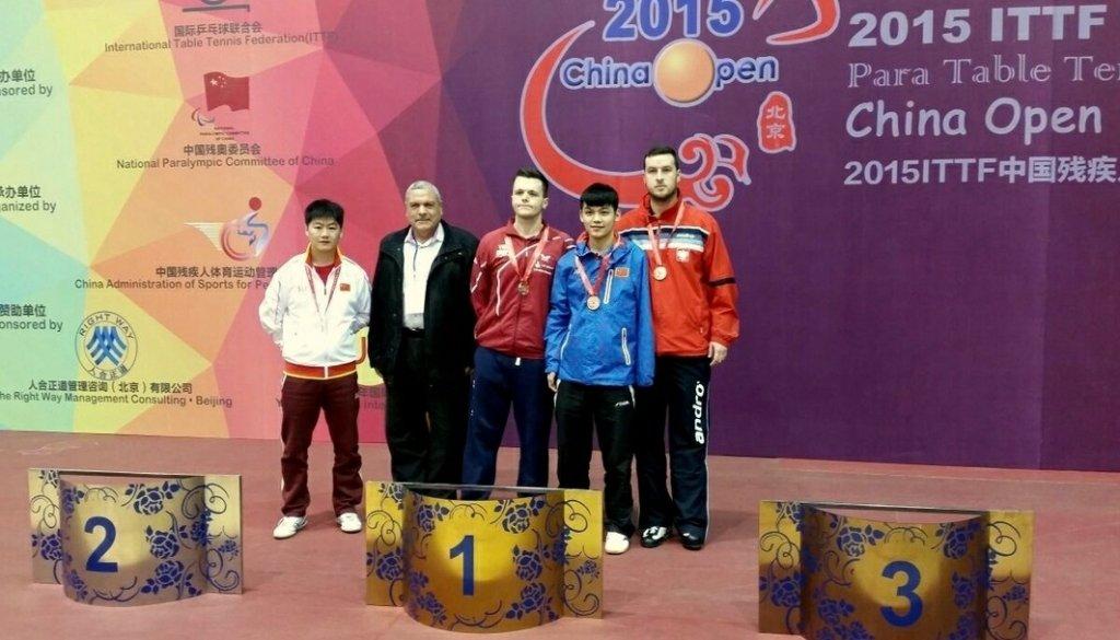Marcin Skrzynecki na podium w Pekinie