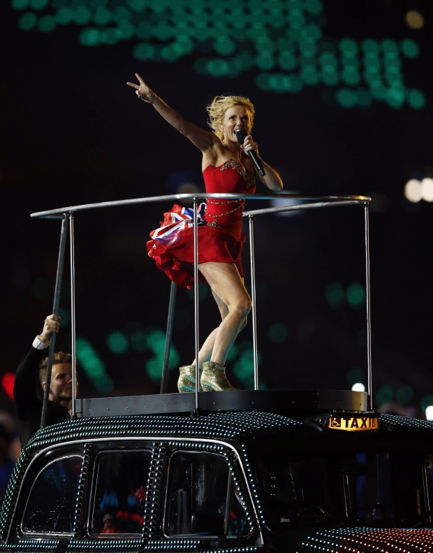 Geri Haliwell of British pop group The Spice Girls performs on the top of a London taxi during the closing ceremony of the London 2012 Olympic Games at the Olympic Stadium August 12, 2012.   REUTERS/Chris Helgren (BRITAIN - Tags: ENTERTAINMENT SPORT OLYMPICS)