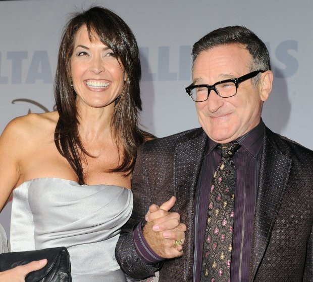 FILE - This Nov. 9, 2009 file photo shows actor Robin Williams, right, and  his wife Susan Schneider at the premiere of
