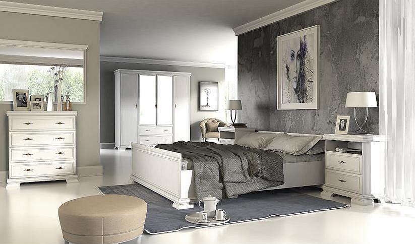 Białe łóżko dwuosobowe.