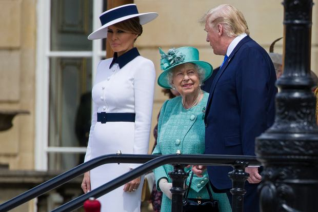 First lady Melania Trump, left, stands as Queen Elizabeth II smiles while talking with President Donald Trump at Buckingham Palace, Monday, June 3, 2019, in London. (AP Photo/Alex Brandon)
