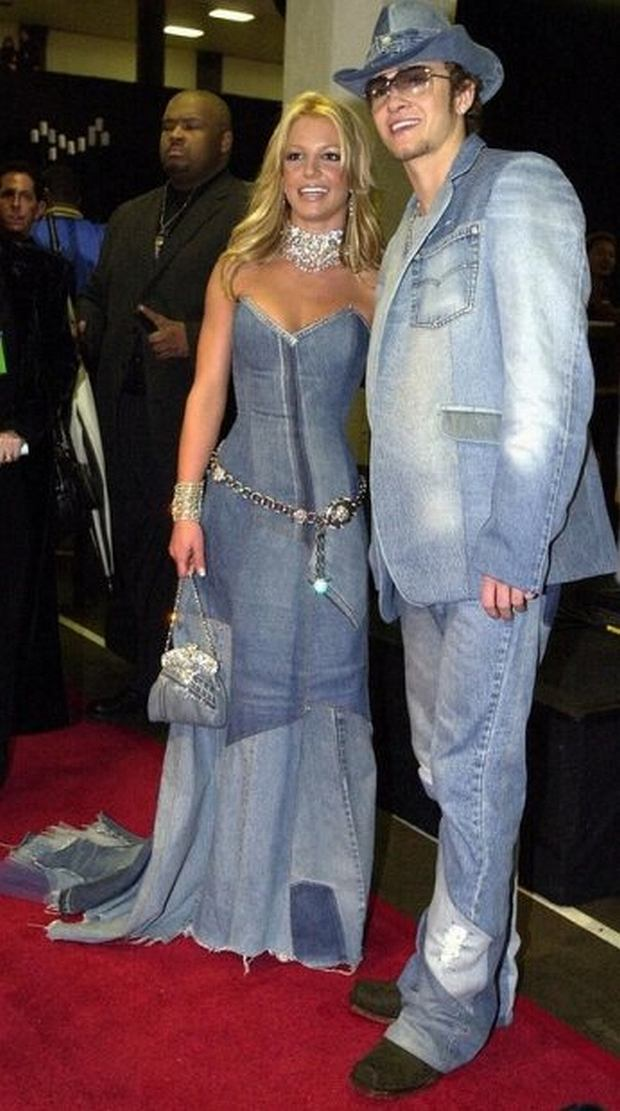 PHOTO: EAST NEWS/AFP Pop star Britney Spears (l) and her boyfriend, singer Justin Timberlake of the group NSYNC arrive backstage at the 28th Annual American Music Awards 08 January 2001 in Los Angeles. Spears is co-hosting the award show this year along with rapper/actor LL Cool J. AFP Photo Lucy NICHOLSON