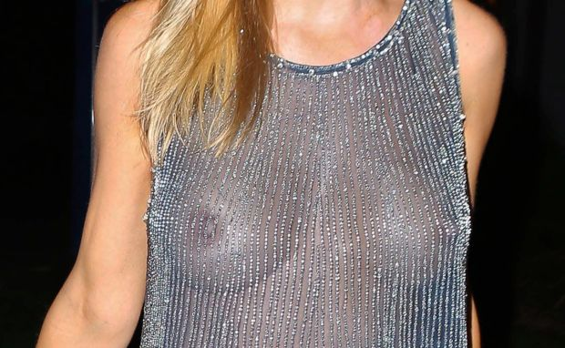 Joanna Krupa giving the paps a free peepshow while wearing a see-through shimmery top at BOA. Joanna then left with a man in a white Ferrari. October 18, 2012 X17online.com