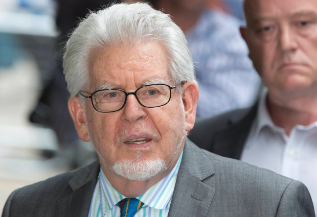 Entertainer Rolf Harris leaves Southwark Crown Court in London June 30, 2014. Harris, a mainstay of family entertainment in Britain and Australia for more than 50 years, was found guilty on Monday of 12 charges of indecently assaulting young girls over a period of nearly 20 years.  REUTERS/Neil Hall (BRITAIN - Tags: ENTERTAINMENT CRIME LAW)