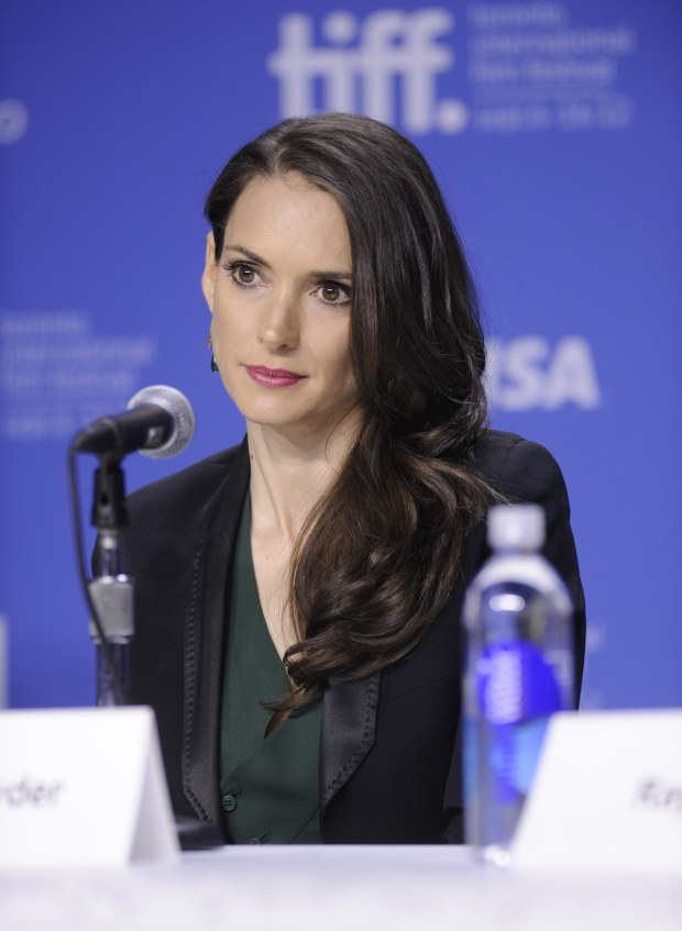 "Actress Winona Ryder participates in a photo call and press conference for the film ""The Iceman"" at TIFF Bell Lightbox during the Toronto International Film Festival on Monday Sept. 10, 2012 in Toronto. (Photo by Evan Agostini/Invision/AP)"