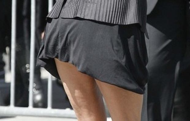 Janice Dickinson is all smiles as she shows off her legs in a short skirt as she shows up to the 'American Idol' finale show.  Pictured: Janice Dickinson