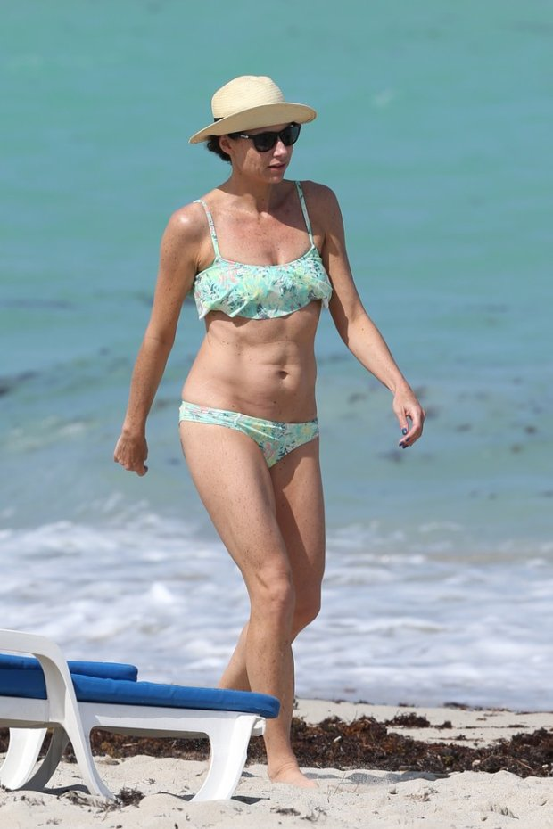 116210, Minnie Driver shows off her bikini body a green flower print bikini on the beach in Miami. The 44 year old 'About a Boy' actress  is enjoying some vacation time with her son Henry and other family members in Miami after a busy few months filming the new NBC comedy. Miami, Florida - Tuesday April 08, 2014. Photograph: Brett Kaffee/Thibault Monnier ? Pacific Coast News. Los Angeles Office: +1 310.822.0419 London Office: +44 208.090.4079 sales@pacificcoastnews.com FEE MUST BE AGREED PRIOR TO USAGE