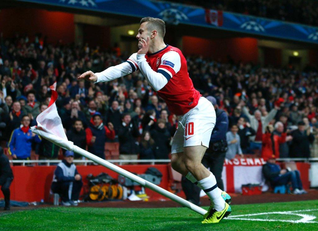 Wilshere'a taniec z chorągiewką. Anglik strzelił oba gole dla Arsenalu w wygranym 2:0 na The Emirates meczu z Marsylią. Ozil zmarnował karnego. Kanonierzy nie mogą być jednak jeszcze pewni awansu - Napoli musi ich rozgromić w ostatniej kolejce, żeby (ewentualnie) awansować ich kosztem.