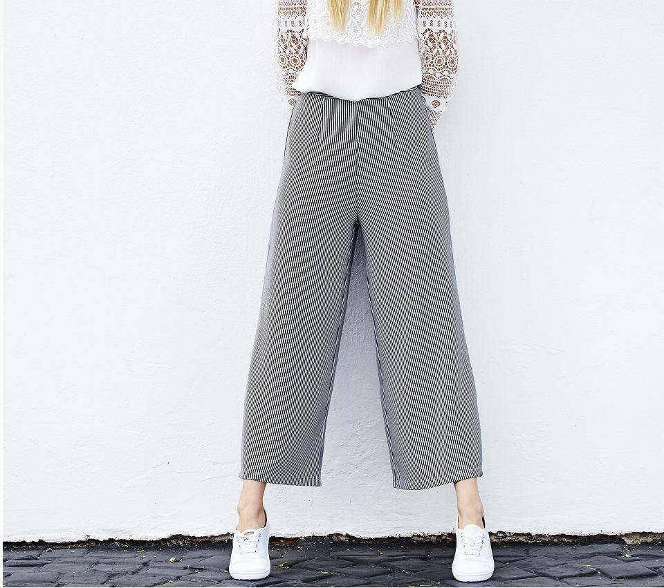 Spodnie materiałowe z szerokimi nogawkami - culottes