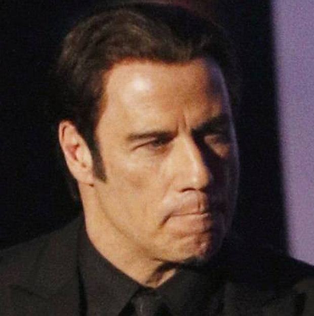 Presenter John Travolta takes the stage at the 85th Academy Awards in Hollywood, California, February 24, 2013.   REUTERS/Mario Anzuoni (UNITED STATES  - Tags: ENTERTAINMENT)   (OSCARS-SHOW)