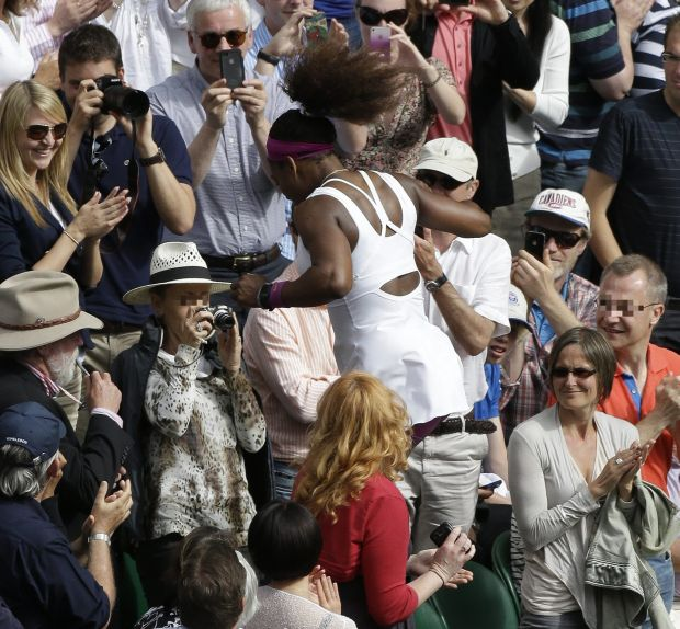 Serena Williams of the United States reacts after defeating Agnieszka Radwanska of Poland to win the women's final match at the All England Lawn Tennis Championships at Wimbledon, England, Saturday, July 7, 2012. (AP Photo/Anja Niedringhaus, Pool)