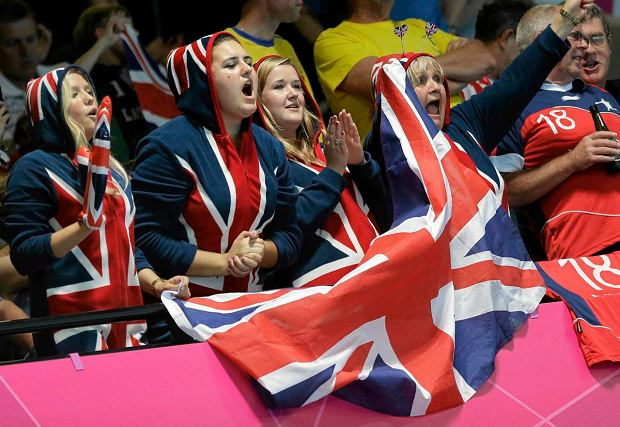 Supporter of Great Britain celebrate their team during the men's handball preliminary match between Great Britain and Sweden at the 2012 Summer Olympics, Tuesday, July 31, 2012, in London. (AP Photo/Matthias Schrader) SLOWA KLUCZOWE: 2012 London Olympic Games Summer Olympic games Olympic games Sports Events XXX Olympiad