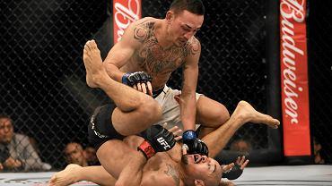 W walce wieczoru dwóch tymczasowych mistrzów wagi piórkowej, spotkało się w klatce na gali UFC 212. Po walce został już tylko jeden - Max Holloway pokonał przed czasem Jose Aldo i to na jego biodrach zawisł pas.