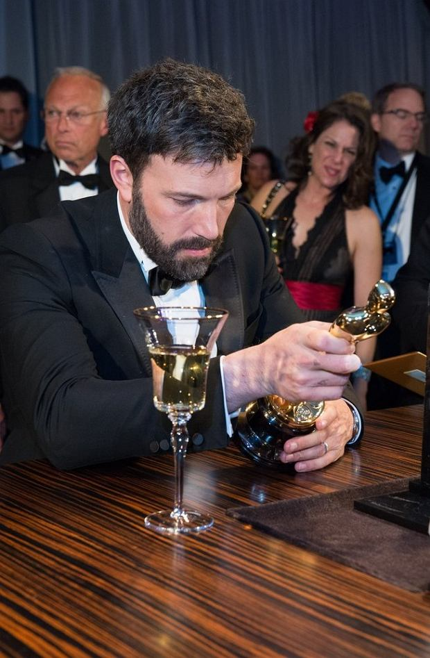 EDITORIAL USE ONLY. NO BOOK PUBLISHING WITHOUT PRIOR APPROVAL  Mandatory Credit: Photo by A.M.P.A.S. / Rex Features (2165871l)  Ben Affleck, winner for or Best motion picture of the year for