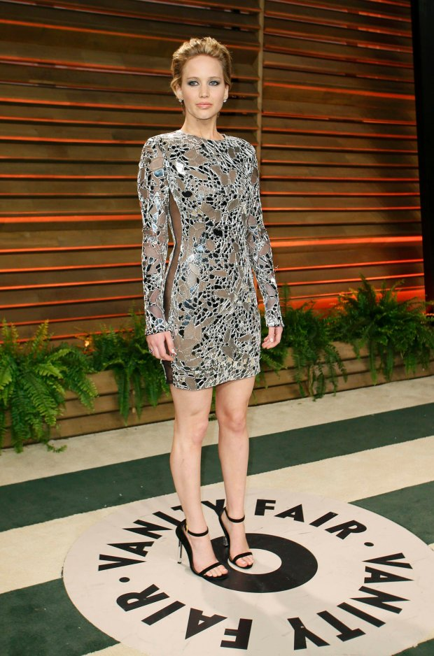 Actress Jennifer Lawrence arrives at the 2014 Vanity Fair Oscars Party in West Hollywood, California March 2, 2014. REUTERS/Danny Moloshok (UNITED STATES TAGS: ENTERTAINMENT) (OSCARS-PARTIES)