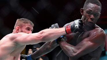 Jan Błachowicz wymierzający cios w Israel Adesanya (Źródło: Facebook) UFC 259.