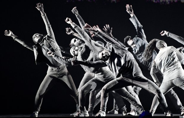 Dancers perform the choreography