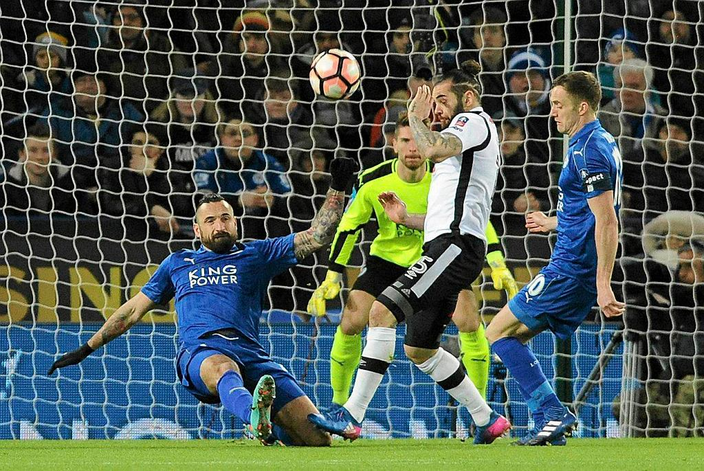 Derby's Bradley Johnson, right, is blocked by Leicester's Marcin Wasilewski